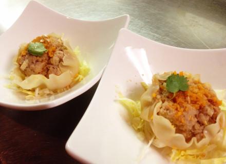 Kanoom jeeb (pork dumpling) served with  Worcestershire sauce on the side.