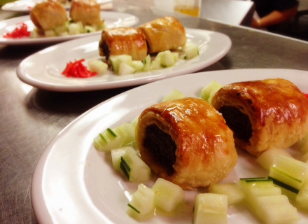 Spiced beef sausage stuffed in crispy puff pastry served with cucumber salad.