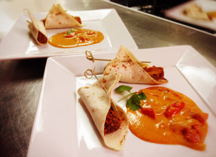 Crispy Duck in a flour tortilla served in red curry sauce.