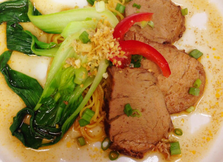 Slow cooked pork over noodles with pickled vegetables. Was served with Châteaunuf-du-Pape.