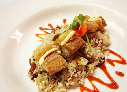 Crispy pork belly with kalamata olive and bacon infused rice