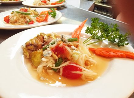 Grilled chicken thigh with blue cheese papaya salad