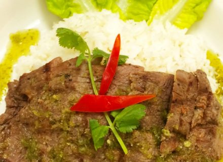 Grilled steak served with spicy lime sauce