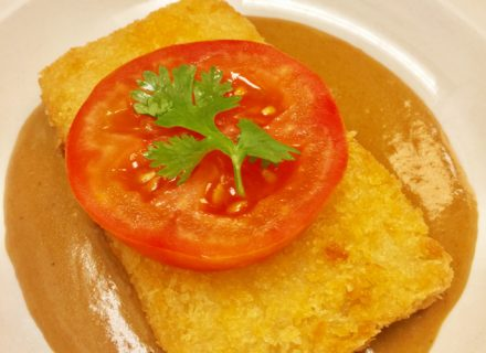 Panko encrusted Colby Jack in tomato curry sauce