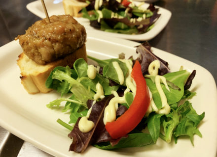 Bangkok pork slider, baby greens and honey mustard sauce paired with a petit verdot.