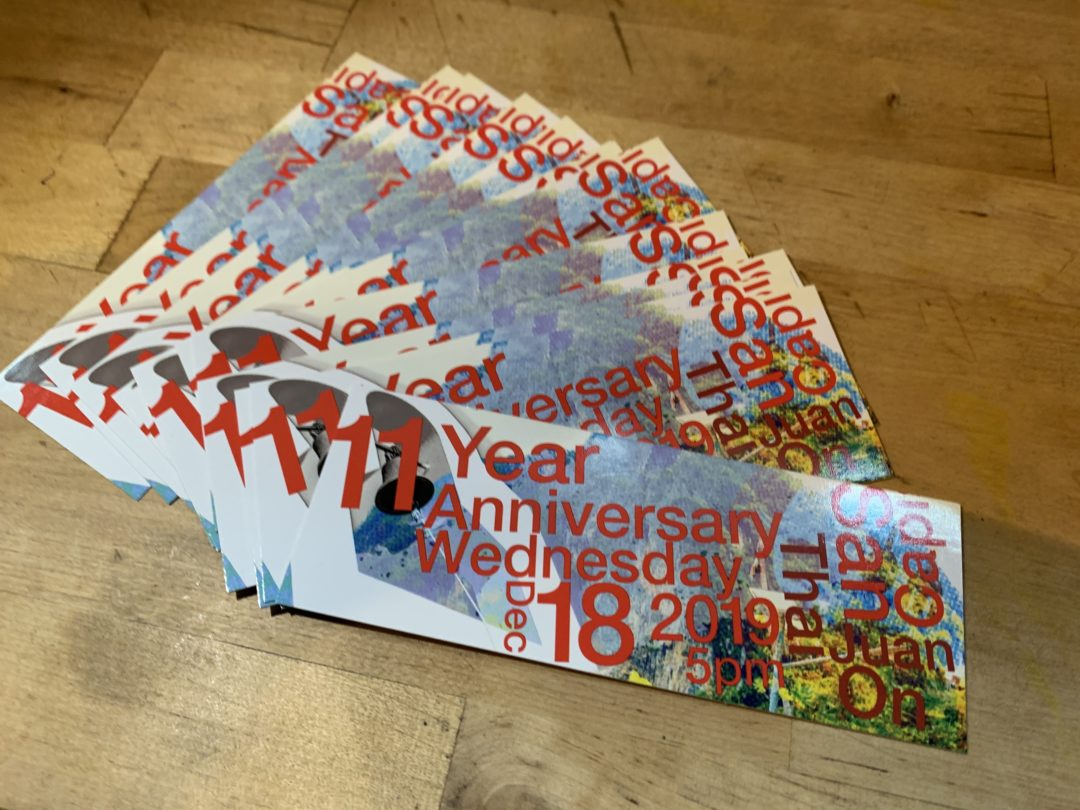 A picture of the tickets to the anniversary party
